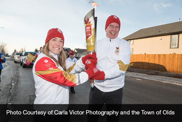 Former President Among Winter Games Torch Bearers