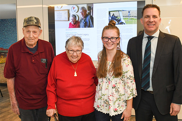 Shayelyn Scott, Agriculture Management Diploma student, accepts the inaugural George and Margery Steckler Fall Award from George and Marge Steckler and Olds College President Stuart Cullum.